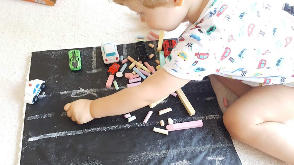 Toddler draws shapes on DIY Car Play Mat