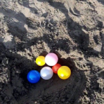 Outdoor Toddler Activity: Balls in the Sand